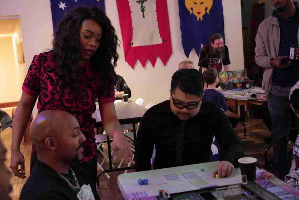 Keisha explaining the rules of Project Violacea. Keisha was the one who first started the idea for the game and assembled the team to make it a reality.