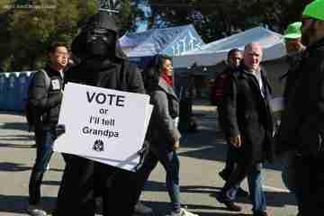 daniel jun kim (aka the pop mythologist) dressed as Kylo Ren and encouraging people to vote